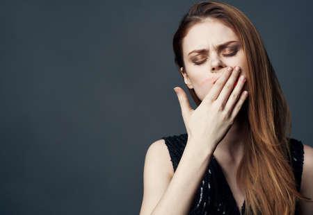Charming woman smears lipstick all over her face Фото со стока