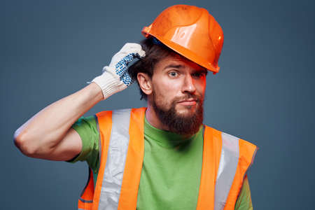 worker man in construction uniform professional lifestyle blue background