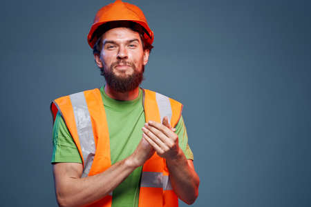 Cropped view of bearded man in working uniform construction engineer
