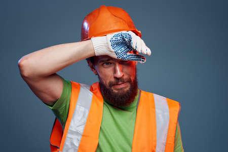 A man in orange paint. Hard work of a builder