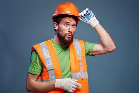 Bearded man Construction uniform hard work profession blue background