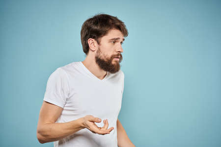 Bearded man emotions white t-shirt lifestyle gestures with hands blue backgrounds Stockfoto