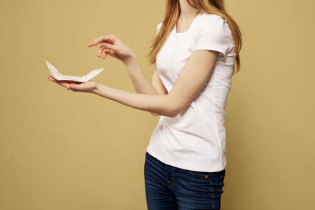 girl in jeans with a pad in hand hygiene clean appearance
