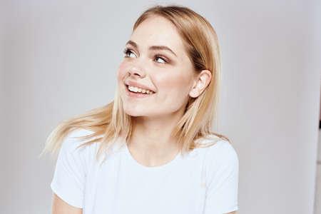 emotional blonde white t-shirt close-up studio lifestyle fun