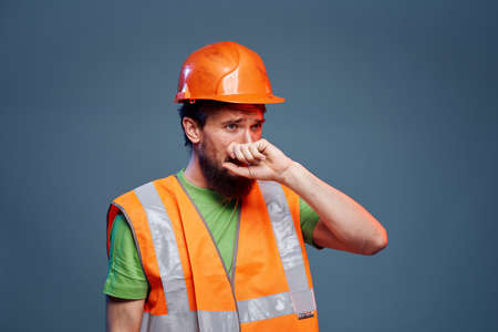 Bearded man in orange paint construction safety hard work