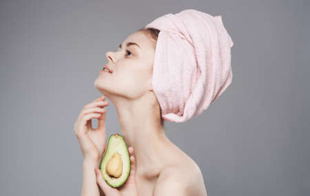woman with a towel on her head clean skin bare shoulders exotic fruits luxury