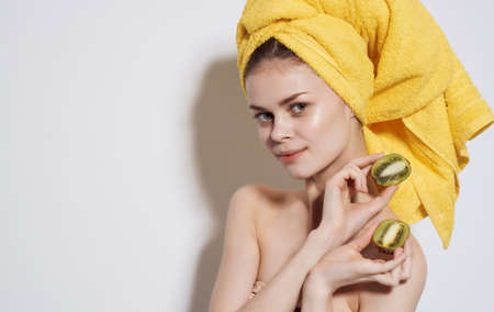 Woman in a yellow towel on her head exotic fruits skin care