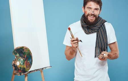 Male artist in white t-shirt easel art hobby Creative approach