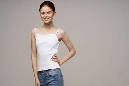 pretty woman in t-shirt and jeans studio freedom