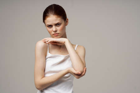 disgruntled woman elbow pain massage health studio Imagens