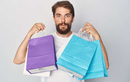 Bearded man with packages in hands cropped isolated background Shopping