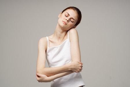 disgruntled woman elbow pain massage health studio