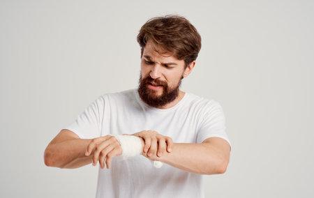 bearded man on patient bandaged hand health problems hospital medicine Standard-Bild