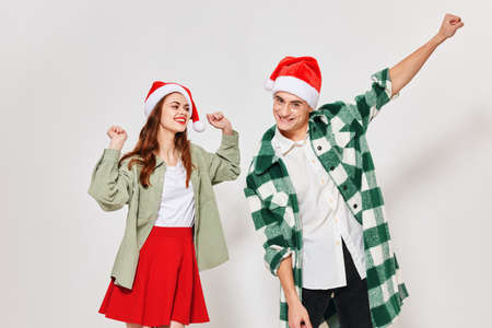 enamored man and woman gesturing with their hands on a light background fun New Year Standard-Bild