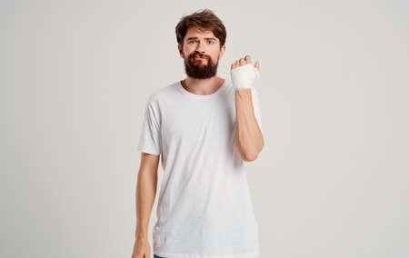 bearded man on patient bandaged hand health problems hospital medicine