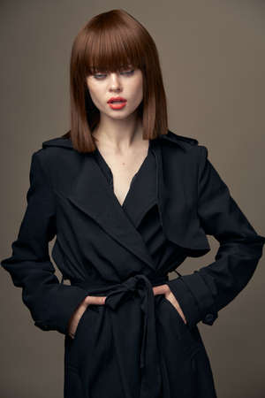 Close-up pretty model European appearance black coat