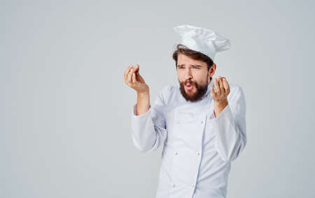 Emotional chef in a headdress gestures Copy Space hands