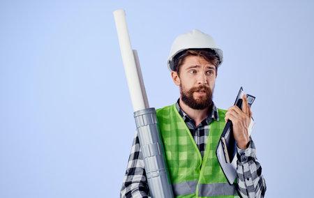 bearded builder white helmet blueprints work professional engineer 免版税图像