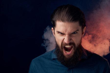 Cute bearded man in shirt elegant style close-up dark background