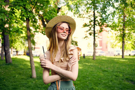 Pretty woman in sunglasses outdoors in summer in the park rest 写真素材