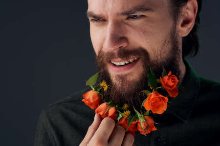 Nice man and flowers in the city decoration charm close-ups Studio