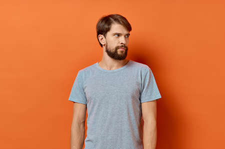 bearded man in gray t-shirt lifestyle Studio isolated background
