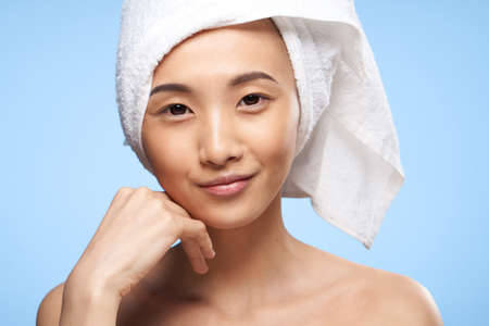 asian woman shoulders towel on head spa treatments close-up