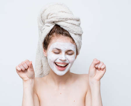 pretty woman with a towel on her head face mask shoulders attractive look