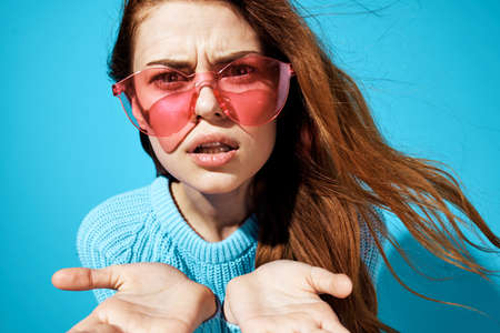 pretty woman in pink glasses blue sweater emotions close-up attractive look