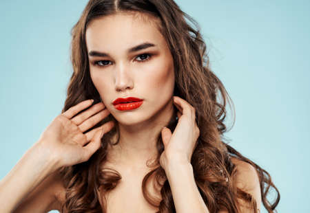 Sexy brunette red lips bared shoulders romantic look model makeup