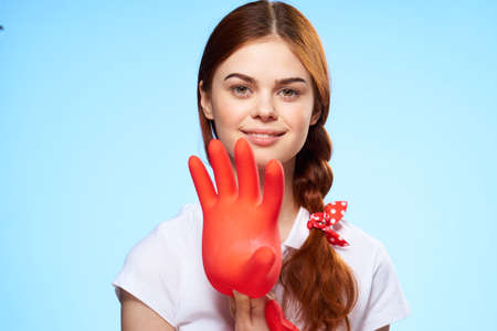 cleaning lady with inflated rubber glove in hand lifestyle fun