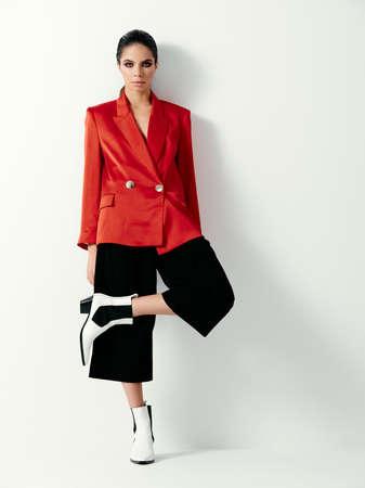 glamorous woman red blazer fashion clothing modern style light background