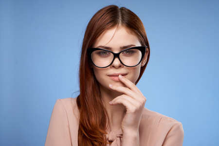 woman wearing glasses pink shirt elegant style attractiveness blue background Stock fotó