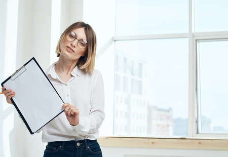room finance woman business documents interior window