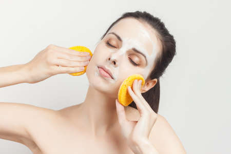 woman with cream mask on face skin care rejuvenation