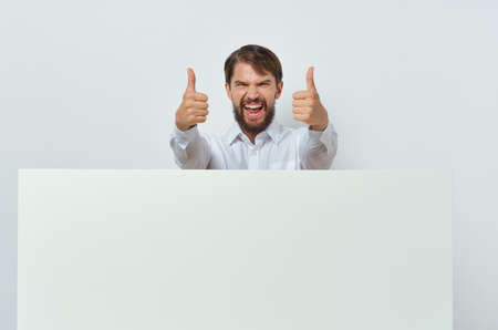 emotional man in shirt gesturing with his hands white mockup business advertisement