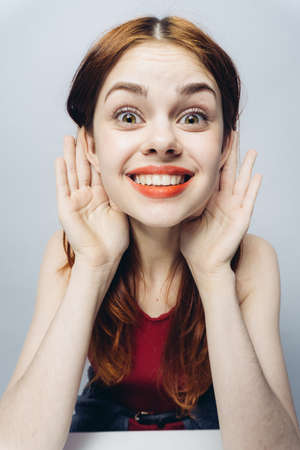 cheerful woman with wide open mouth spread her ears close-up emotions