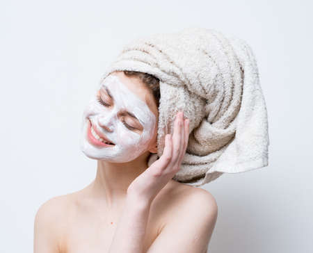 pretty woman face moisturizer white mask shoulders towels