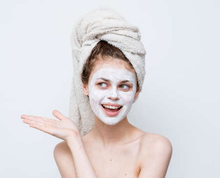 cheerful woman with shoulders gesturing with hands cream face mask emotions