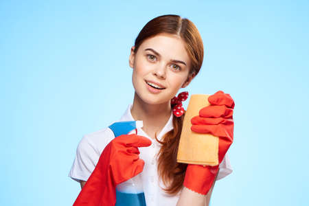 cheerful cleaning lady cleaning supplies home care service blue background