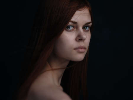 Romantic red-haired woman portrait close-up naked shoulders cropped view Foto de archivo