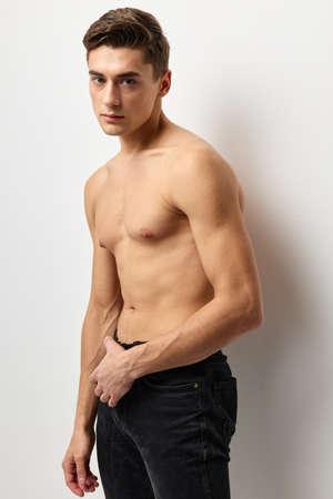 handsome man fashion hairstyle torso cropped view studio posing Stockfoto