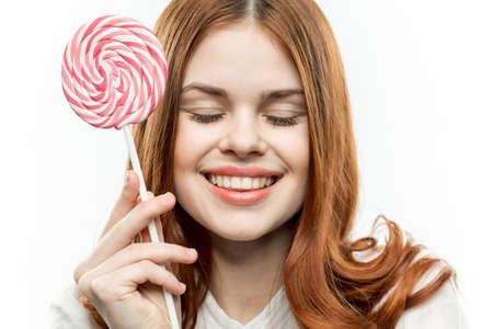 cute woman with lollipop behold street delight sweets