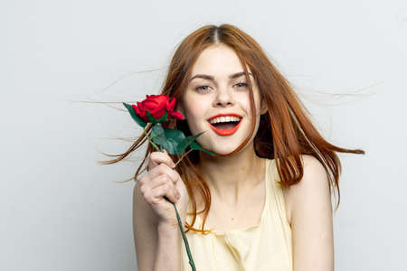 attractive woman with rose flower charm smile