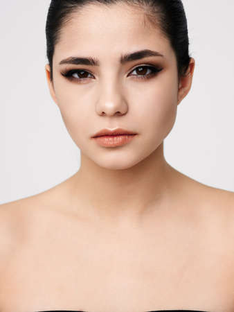 attractive brunette naked shoulders makeup facial closeup