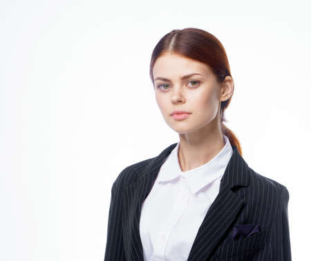 woman in suit official cropped view office light background