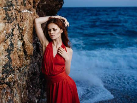 Attractive woman red dress ocean luxury model