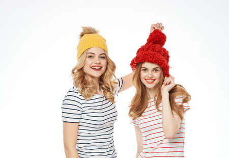 funny friends in warm hats hug friendship joy communication Imagens