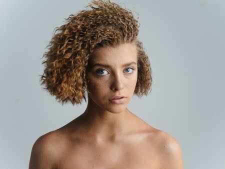 Woman with hair shoulders clean skin cosmetics model