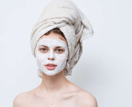 pretty woman with towel on head emotions shoulders and mask on face